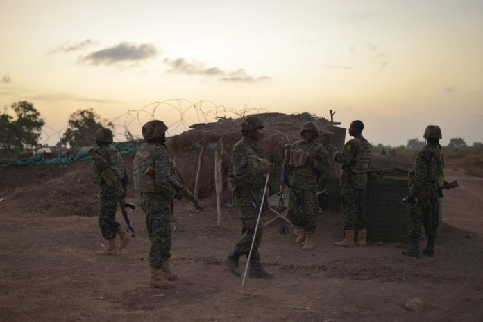 African Union soldiers prepare for an attack on al-Shabaab rebels in southern Somalia.  [AMISOM]