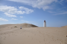 Surrounded by sand, the lighthouse at Rubjerg Knude is expected to crash into the sea by 2020 [Simon Hooper]