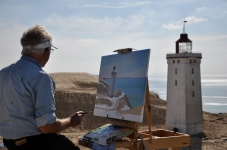 Artist John Kristensen has painted Rubjerg Knude every year since the 1970s [Simon Hooper]