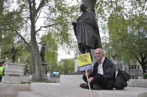 Donnachadh McCarthy, in front of the statue of Mahatma Gandhi [Simon Hooper]