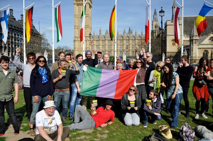 Occupy activists pose with a proposed republican English flag [Simon Hooper]